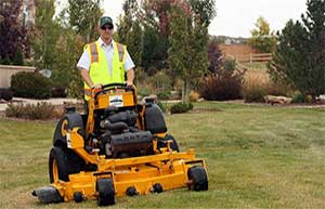 Man mowing a commercial property